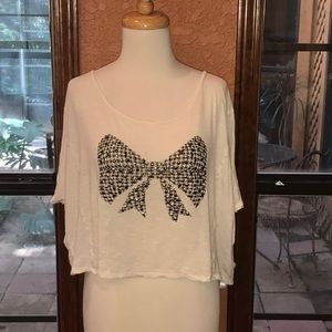 Top with studded bow